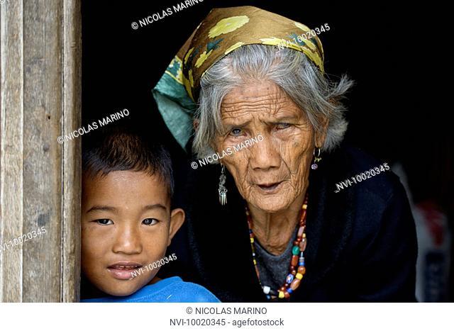 Igorot grandmother and grandchildren, North Luzon, Philippines