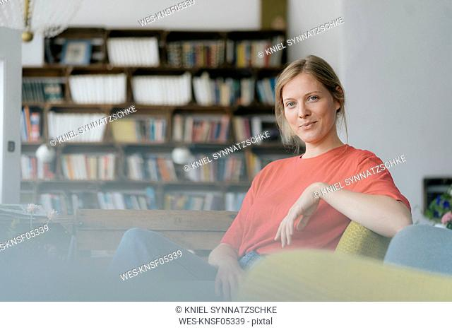 Portrait of smiling young woman sitting in a cafe