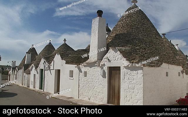 Alberobello, Apulia, Italy, 2018 : conical beehive shaped roofs of the stone built historical trullo traditional of Alberobello, zoom back