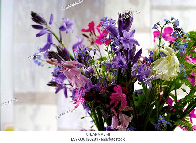 Bouquet with fresh colorful spring forest flowers and hyacinths, mothers day concept