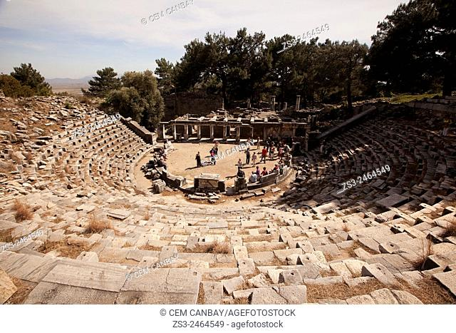 Tourists at the ancient amphitheater in the ruins of Priene, Aydin Province, Turkey, Europe