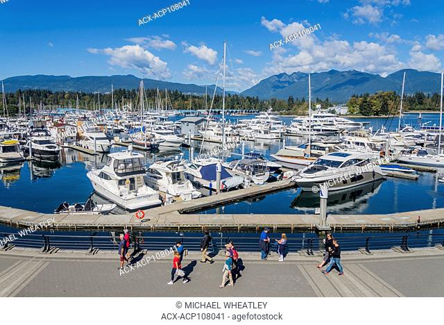 People strolling the Seawall, Coal Harbour, Vancouver, British Columbia, Canada