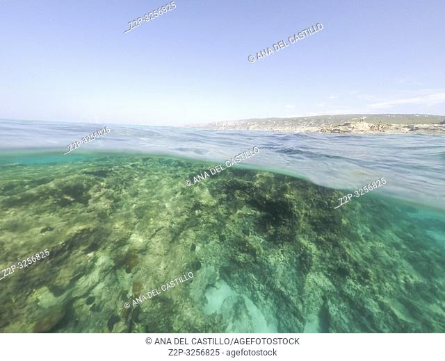 Underwater the turquoise water in El Calo de San Agusti Formentera island Balearics Spain
