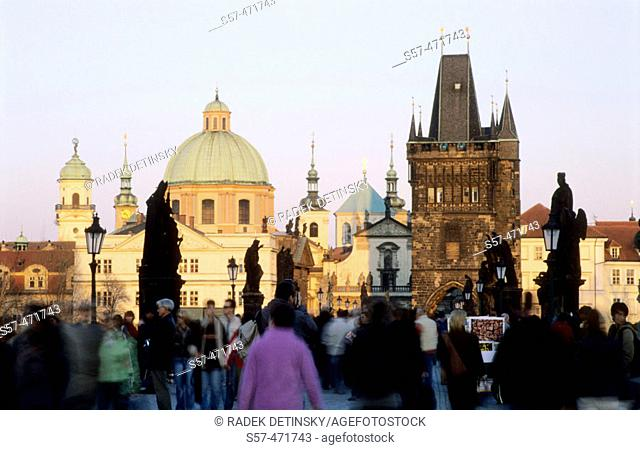 evening on Charles Bridge, St. Francis church, Old Town tower, Prague, Czech Republic