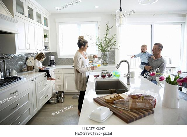 Family together in morning kitchen