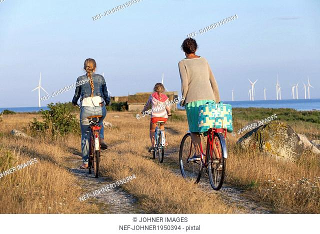 Mother with daughters cycling, Oland, Sweden