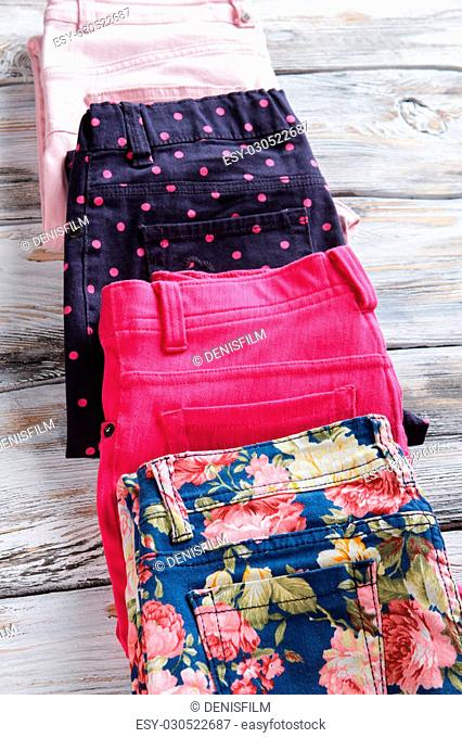 Lady's trousers with stylish print. Pink dots on navy pants. New fashionable clothes on display. Lowest prices for authentic items