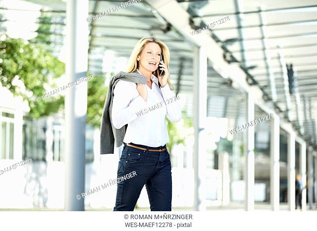 Successful businesswoman using smartphone