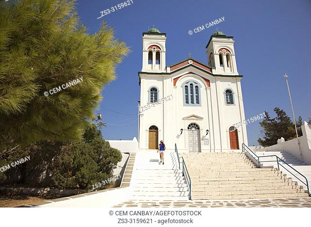 Tourist climbing up the stairs of the Church Of The Assumption Of The Virgin in Naoussa village, Paros Island, Cyclades Islands, Greek Islands, Greece, Europe
