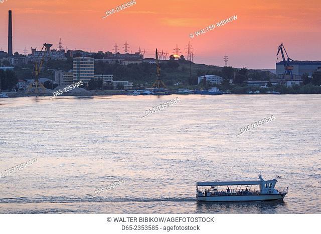 Romania, Danube River Delta, Tulcea, elevated view of river ferry to Tudor Vladimirescu on the Danube River, sunset