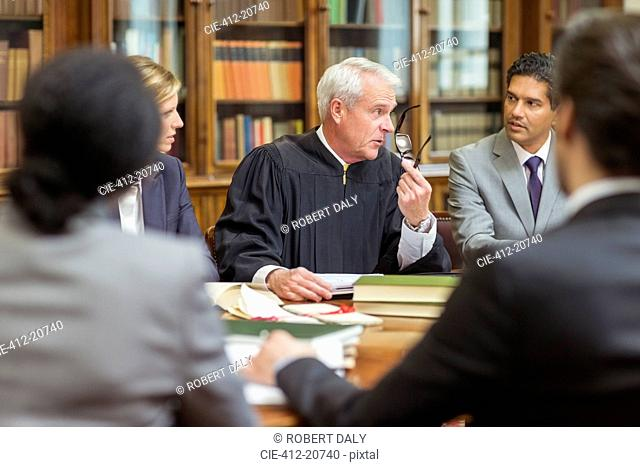 Judge and lawyers talking in chambers