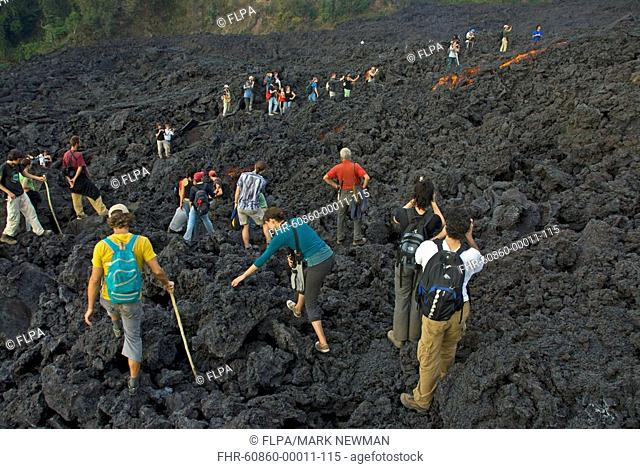 Tourists at active lava flow on complex volcano, Pacaya Volcano, Guatemalan Highlands, Guatemala