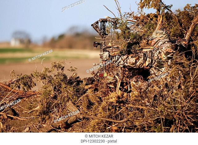 Turkey Hunter Sits In Ground Blind Made From Natural Materials