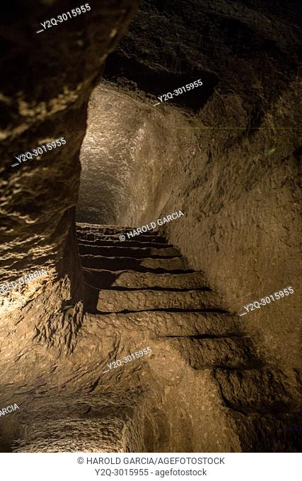 Indian staircase with trap on one side indian cave in La Piramide. Tierradentro National archeological park. Department of Cauca, Colombia