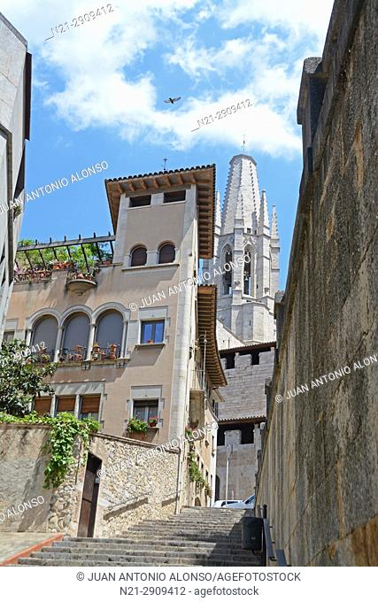 Stairs leading to the Pujada -the slope- de Sant Feliu. The tower of the Church of Sant Feliu can be seen in the background