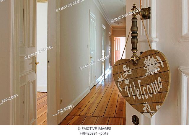 Welcome sign at door knob