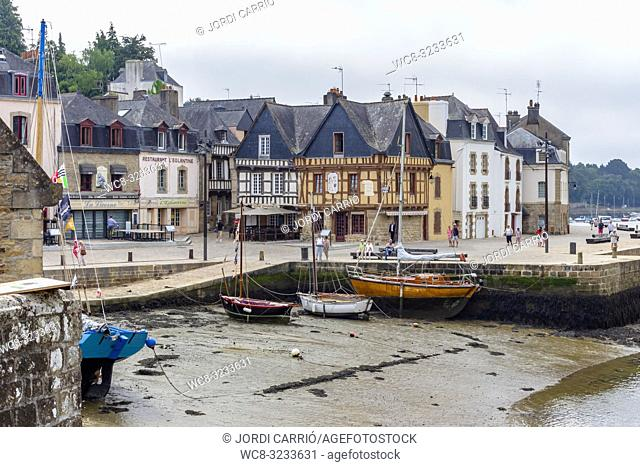 PORT OF SAINT-GOUSTAN, BRITTANY, FRANCE: View of the Benjamin Franklin pier plaza, where the fishing barges remain anchored at low tide