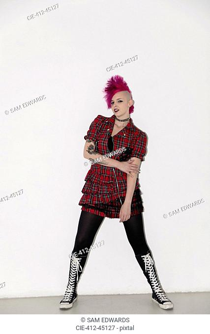 Portrait confident young woman with pink mohawk