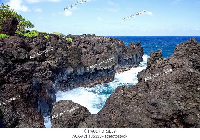 Waves and lava rocks at Wai'anapanapa State Park, Maui, Hawaii