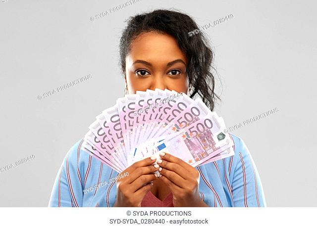 excited african american woman with euro money