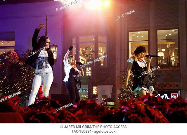 (L-R) Kiely Williams, Adrienne Bailon, Sabrina Bryan of The Cheetah Girls performing at the annual holiday tree lighting extravaganza and concert at the Grove...