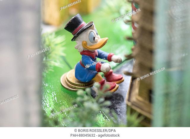 Dagobert Duck sits among the bank towers in the new model of the city of Frankfurt, Germany, 13 February 2017. The 70 squaremetres large model of the Dutch...