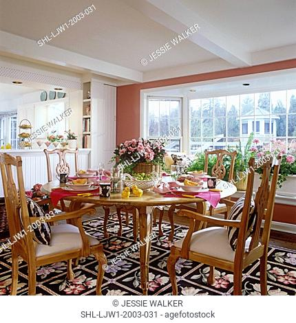 DINING ROOMS: Chippendale chair and round table. Floral rug, pink azaleas and ivy in centerpiece arrangement, set for breakfast, chick salt and pepper shakers