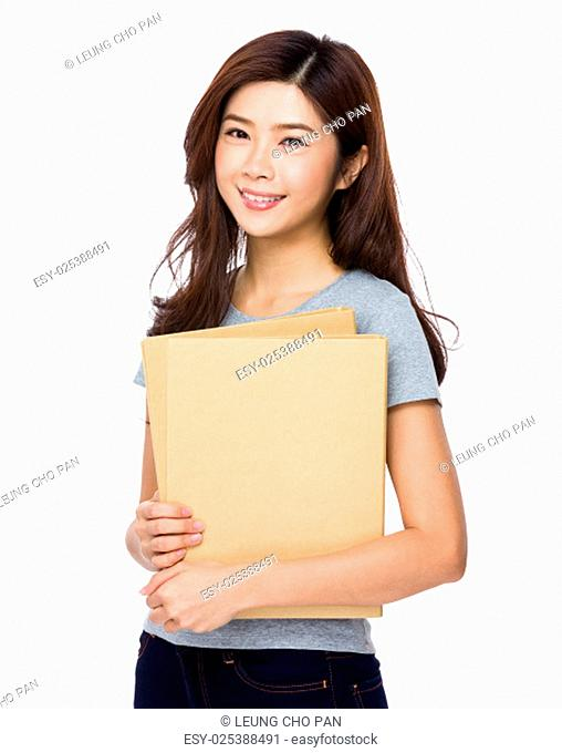 Young school girl hold with file pad