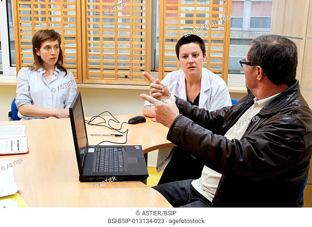 Clinical research in the Saint-Philibert hospital GHICL in Lille, France. A deaf patient having a cognitive evaluation. It involves various tests and exercises...