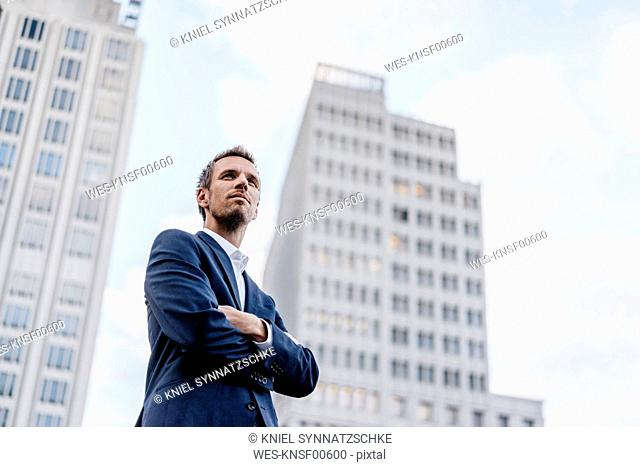 Germany, Berlin, portrait of businessman with arms crossed