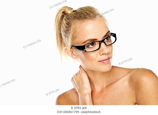 Beautiful blonde woman with bare shoulders wearing modern trendy glasses isolated on white