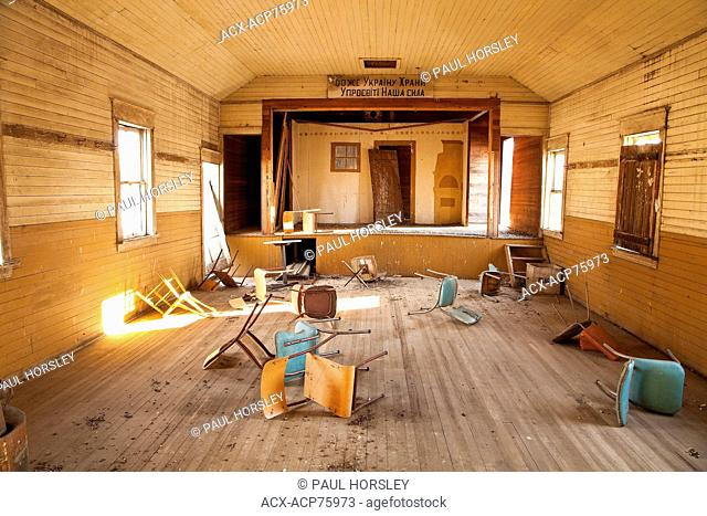 Chairs in abandoned community hall, Alberta, Canada