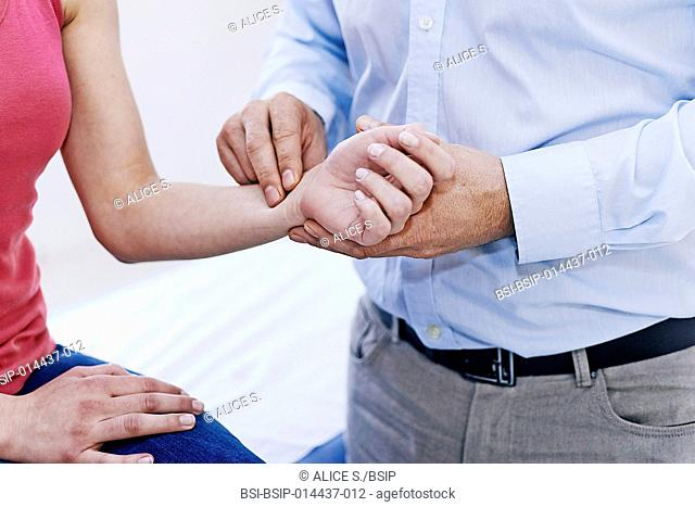Doctor taking a patient's pulse