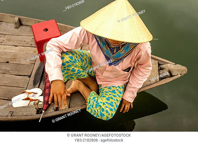 A Local Woman Wait For Tourists To Take Out On River Boat Trips, Hoi An, Quang Nam Province, Vietnam