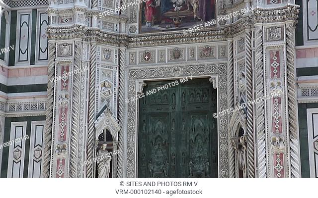 Exterior, TILT up, daylight, view of the main facade. Seen is the main portal from the beginning of the 20th century. Seen also is its lunette with a mosaic of...