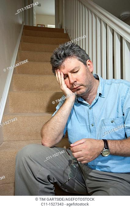 middle aged man feeling depressed