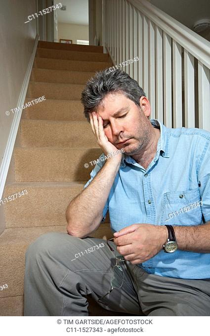 middle aged man feeling depressed