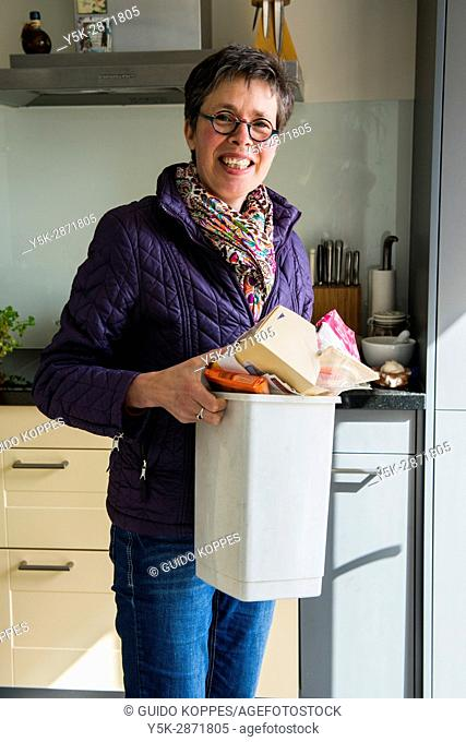 Tilburg, Netherlands. Female multiple sclerosis patient still maintaining her household intependently