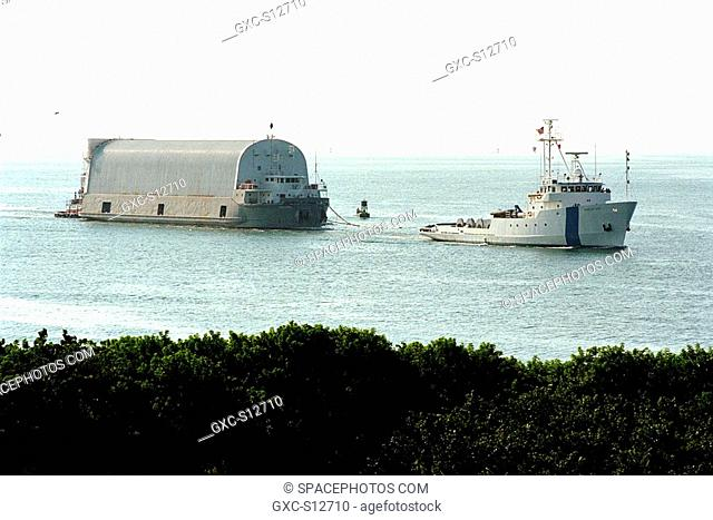 06/16/1998 -- Freedom Star, one of NASA's two solid rocket booster recovery ships, tows a barge containing the third Space Shuttle super lightweight external...