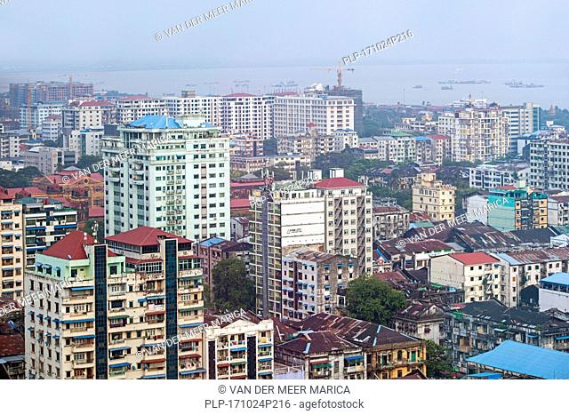 Aerial view over the city Yangon / Rangoon showing skyscrapers, flats and office buildings, Myanmar / Burma