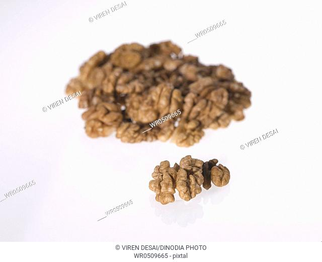 Dryfruit and nut , walnuts on white background