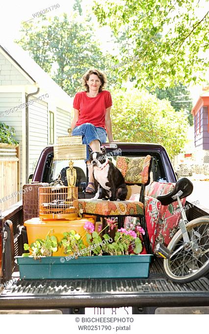 Woman with loaded pickup and dog