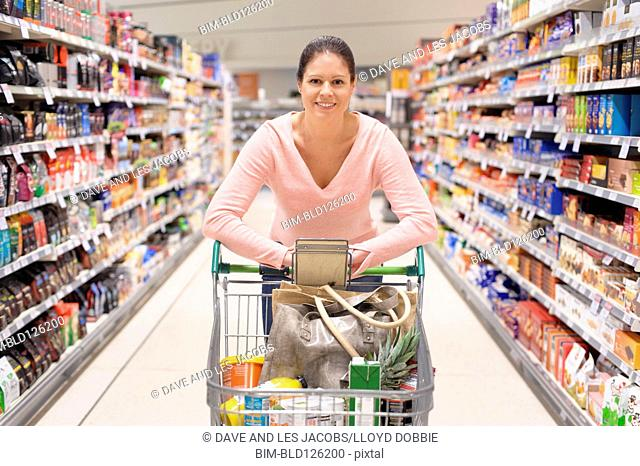 Portrait of Hispanic woman shopping in supermarket