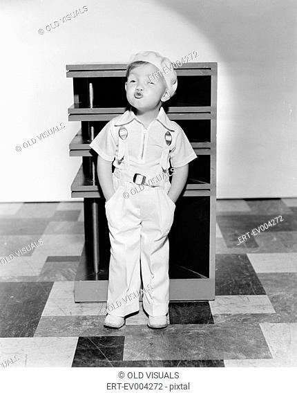 Little boy whistling All persons depicted are not longer living and no estate exists Supplier warranties that there will be no model release issues