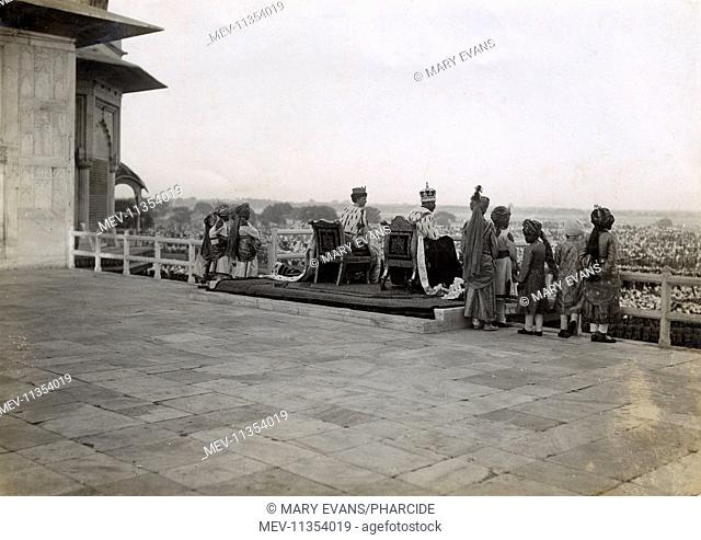 King George V and Queen Mary sitting on their imperial thrones on the day following the Coronation Durbar ceremony in Delhi, India, 13 December 1911