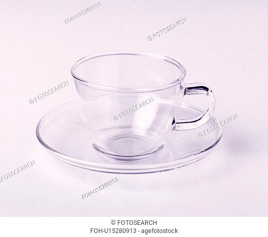 Close-up of glass cup and saucer
