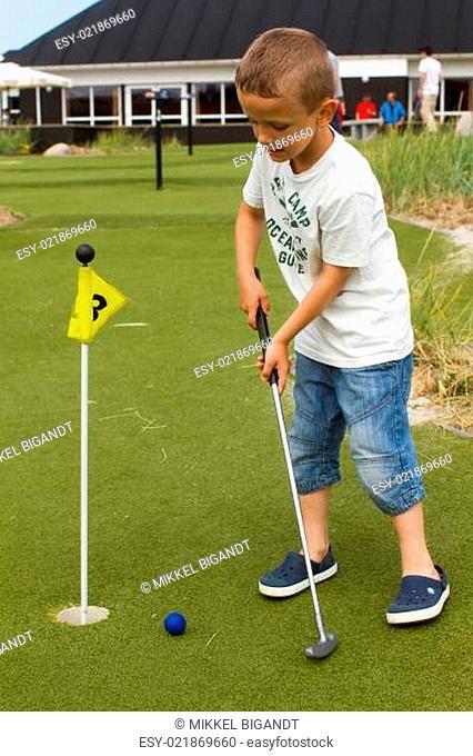 Caucasian boy at mini golf course
