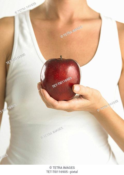 Closeup of woman holding apple