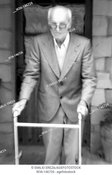 Elderly man with a walking frame