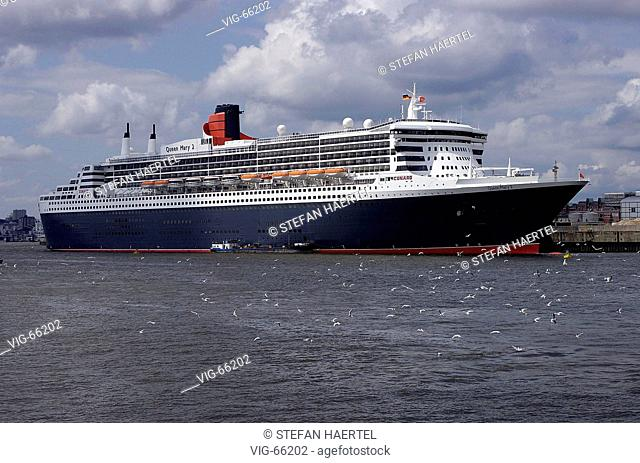 Queen Mary 2, cruise vessel of the shipping company - Cunard - at the cruise terminal in the harbour of Hamburg. - HAMBURG, GERMANY, 19/07/2004